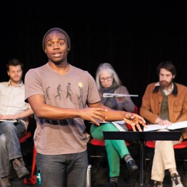 Many Voices Fellow Josh Wilder introducing a scene from his play Leftovers, The Playwrights' Center. Photo by Heidi Bohnenkamp.
