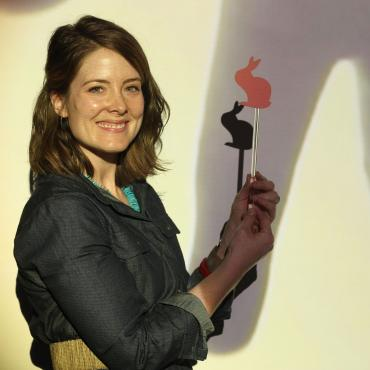 "Megan Flød Johnson holding shadow puppet from ""ShadowDreamScape"", a commission from Children's Discovery Museum in San Jose, CA (2015)."
