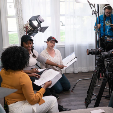 Alison Guessou, directing the cast and crew of the short film Happily Married After.