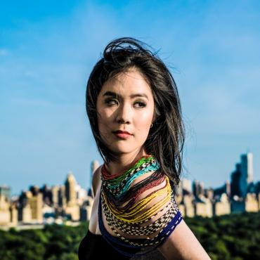 Photo of Stephanie Chou standing with Central Park and Manhattan skyline