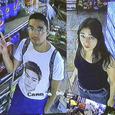 Micaela Durand, a thirty-something Latina woman, and Daniel Chew, a thirty-something Asian man, stand in the aisle of a deli amid a colorful assortment of snacks as seen from a security camera.